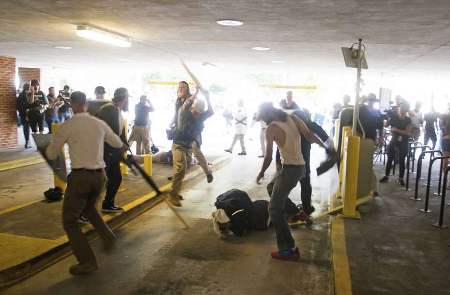 White supremacists beating up black guy in Charlottesville parking garage